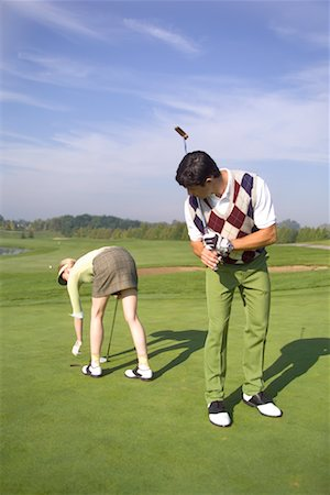 Man Checking Out Woman at Golf Course Stock Photo - Rights-Managed, Code: 700-00453071