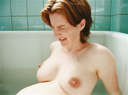 pregnant nipples - Woman in Labor Stock Photo - Rights-Managed, Code: 700-00477488