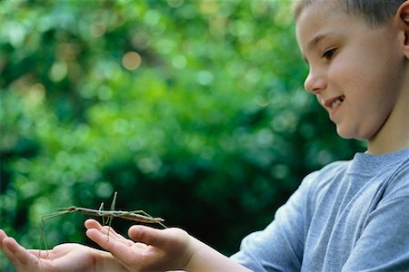 Boy Holding Walking Stick Stock Photo - Rights-Managed, Code: 700-00477664