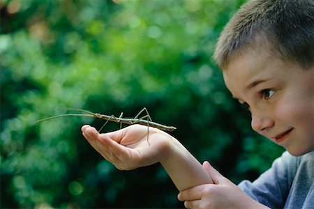 Boy Holding Walking Stick Stock Photo - Rights-Managed, Code: 700-00477663