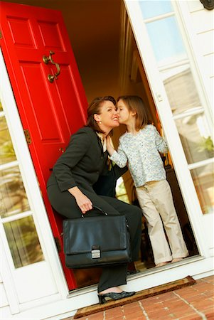 daughter kissing mother - Mother and Daughter in Doorway Stock Photo - Rights-Managed, Code: 700-00478023