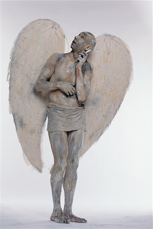 Man Posing as Angel, on Cell Phone Stock Photo - Rights-Managed, Code: 700-00478485