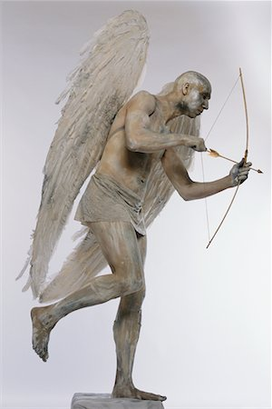 Man Posing as Angel with Bow and Arrow Stock Photo - Rights-Managed, Code: 700-00478481