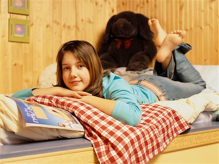 preteen girl feet - Teenage Girl Reading in Bedroom Stock Photo - Rights-Managed, Code: 700-00506895