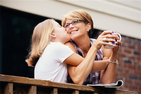 daughter kissing mother - Mother and Daughter Stock Photo - Rights-Managed, Code: 700-00514930