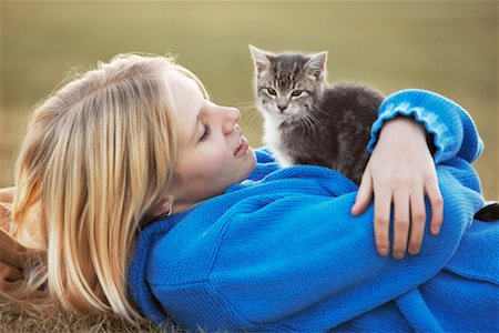 Child Holding Kitten Stock Photo - Rights-Managed, Code: 700-00519374