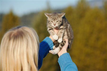 preteen girl pussy - Girl Holding Up Kitten Stock Photo - Rights-Managed, Code: 700-00519375