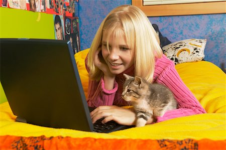 preteen girl pussy - Girl Using Laptop with Kitten Stock Photo - Rights-Managed, Code: 700-00519387