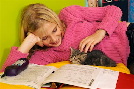 preteen girl pussy - Girl Petting Kitten Stock Photo - Rights-Managed, Code: 700-00519388