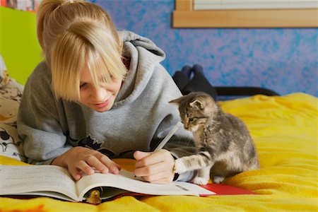 preteen girl pussy - Girl Doing Homework Stock Photo - Rights-Managed, Code: 700-00519394