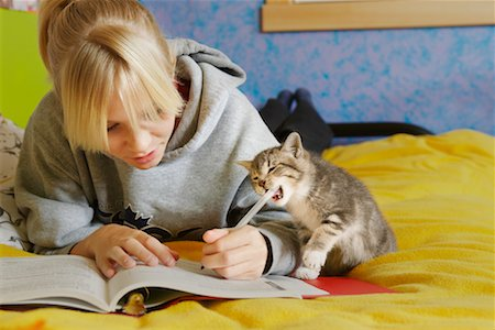 preteen girl pussy - Girl Doing Homework Stock Photo - Rights-Managed, Code: 700-00519395