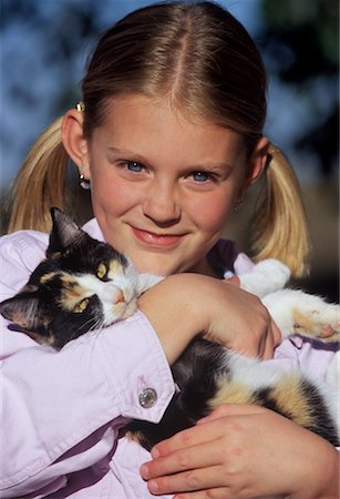 preteen girl pussy - Portrait of Girl With Cat Stock Photo - Rights-Managed, Code: 700-00519462