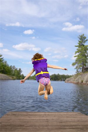preteen girl feet - Child Jumping into Lake Stock Photo - Rights-Managed, Code: 700-00525038