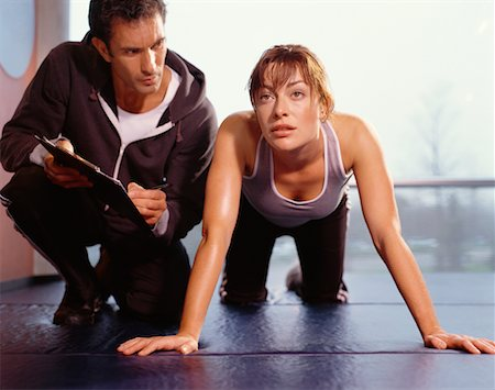 Woman Exercising, With Personal Trainer Stock Photo - Rights-Managed, Code: 700-00526639