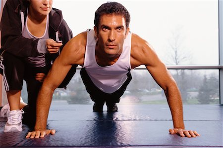 Man Doing Push Ups, Personal Trainer Beside Him Stock Photo - Rights-Managed, Code: 700-00526694
