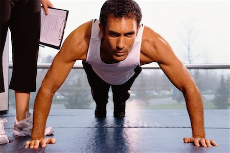 Man Doing Push Ups, Personal Trainer Beside Him Stock Photo - Rights-Managed, Code: 700-00526696