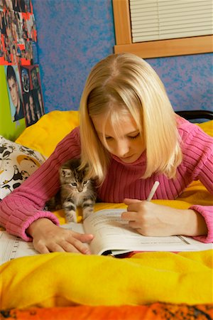 preteen girl pussy - Teenage Girl With Kitten, Doing Homework, British Columbia, Canada Stock Photo - Rights-Managed, Code: 700-00522279