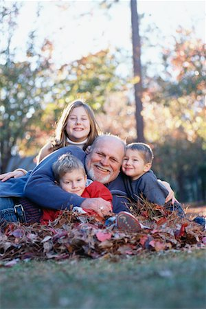 Children with Grandfather in Fall Leaves Stock Photo - Rights-Managed, Code: 700-00522331