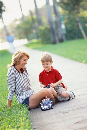Mother and Son with Remote Control Car Stock Photo - Rights-Managed, Code: 700-00522366