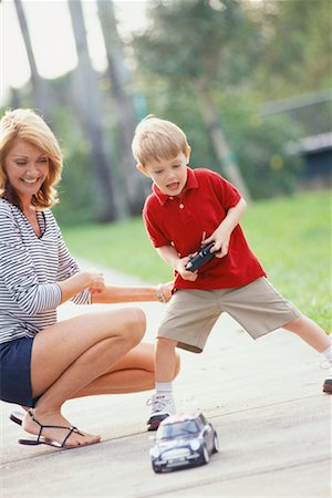 Mother and Son with Remote Control Car Stock Photo - Rights-Managed, Code: 700-00522363