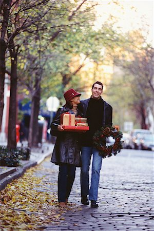 Couple Carrying Christmas Gifts, Greenwich Village, New York, USA Stock Photo - Rights-Managed, Code: 700-00523217
