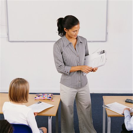 passing of papers in the classroom - Teacher Passing Out Schoolwork Stock Photo - Rights-Managed, Code: 700-00523352