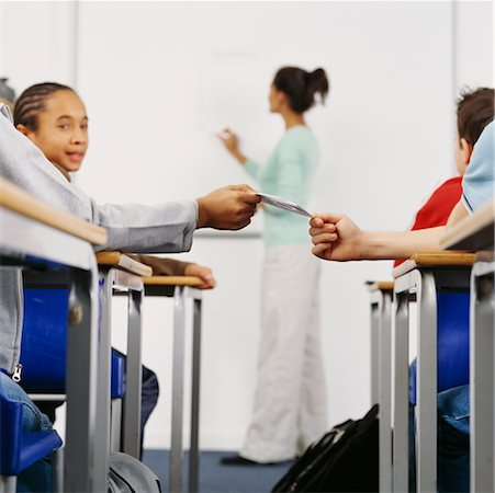 simsearch:600-01184690,k - Students Passing A Note in the Classroom Stock Photo - Rights-Managed, Code: 700-00523377