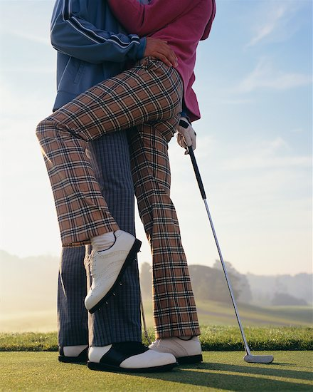 Couple Making Out on Golf Course Stock Photo - Premium Rights-Managed, Artist: Masterfile, Image code: 700-00523825