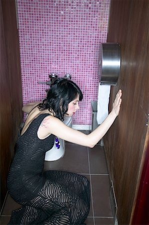 Woman Sitting on Bathroom Floor Stock Photo - Rights-Managed, Code: 700-00544194