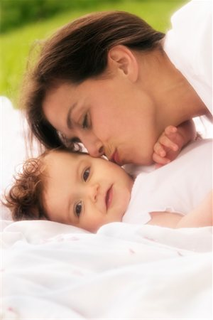 daughter kissing mother - Mother and Daughter Outdoors Stock Photo - Rights-Managed, Code: 700-00544371