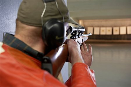 scope - Man Aiming with Scope of Rifle in Firing Booth Stock Photo - Rights-Managed, Code: 700-00546344