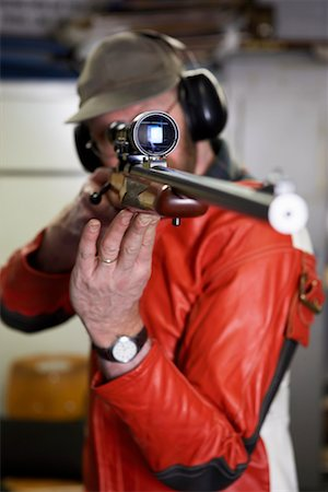 scope - Man Aiming with Scope of Rifle in Firing Booth Stock Photo - Rights-Managed, Code: 700-00546343