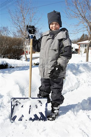 Boy Standing Next to Snow Shovel in Winter Stock Photo - Rights-Managed, Code: 700-00546359