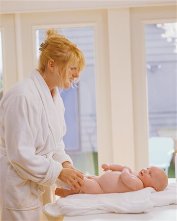 Mother Changing Baby's Diaper Stock Photo - Rights-Managed, Code: 700-00546704