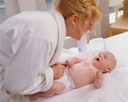 Mother Changing Baby's Diaper Stock Photo - Rights-Managed, Code: 700-00546701
