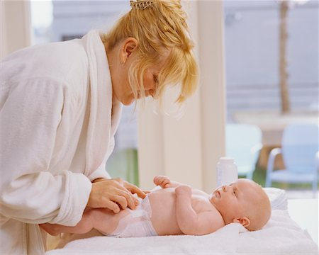 Mother Changing Baby's Diaper Stock Photo - Rights-Managed, Code: 700-00546703