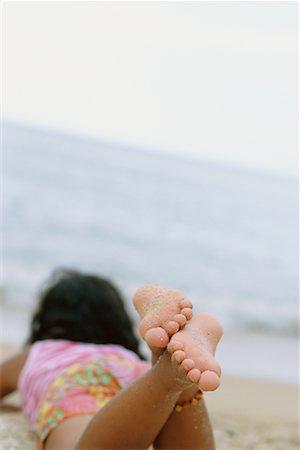 preteen girl feet - Girl Lying on Beach Stock Photo - Rights-Managed, Code: 700-00547238