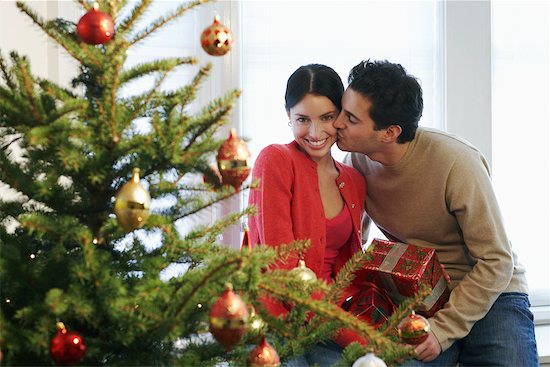 Couple Celebrating Christmas Stock Photo - Premium Rights-Managed, Artist: Jerzyworks, Image code: 700-00547271