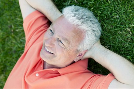 peter griffith - Portrait of Man Lying on Grass Stock Photo - Rights-Managed, Code: 700-00549551