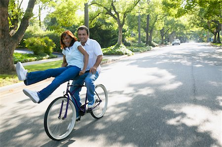 Couple Riding on Bicycle Together, Woman Sitting on Handlebars Stock Photo - Rights-Managed, Code: 700-00549928