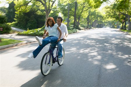 Couple Riding on Bicycle Together, Woman Sitting on Handlebars Stock Photo - Rights-Managed, Code: 700-00549929