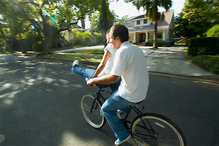 Couple Riding on Bicycle Together, Woman Sitting on Handlebars Stock Photo - Rights-Managed, Code: 700-00549930