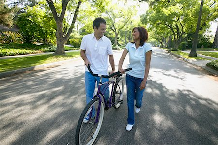 Couple Walking with Bicycle, Down Street Stock Photo - Rights-Managed, Code: 700-00549932