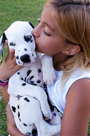 dog kissing girl - Girl With Dalmatian Puppy Stock Photo - Rights-Managed, Code: 700-00543624