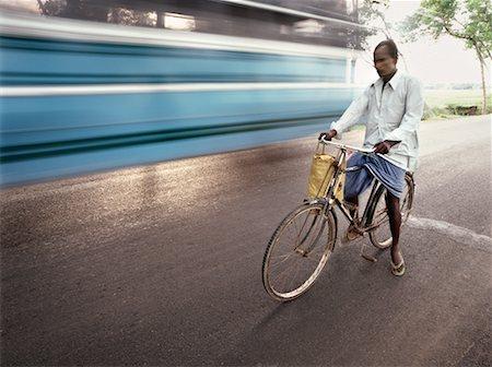 Man Riding Bicycle, Mumbai, India Stock Photo - Rights-Managed, Code: 700-00554721
