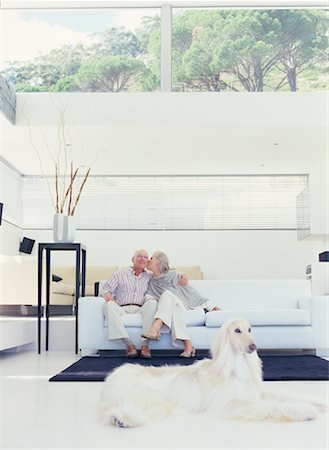 dog kissing man - Portrait of Couple Sitting on Sofa Stock Photo - Rights-Managed, Code: 700-00557018