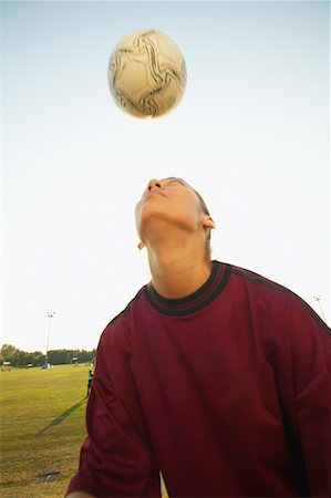 peter griffith - Girl Hitting Soccer Ball Stock Photo - Rights-Managed, Code: 700-00550131