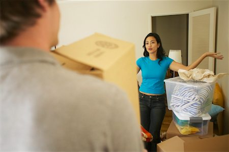 peter griffith - Woman Watching Man Move Boxes On Moving Day Stock Photo - Rights-Managed, Code: 700-00550550