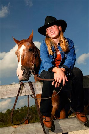 Portrait of Girl Sitting on Fence with Horse Stock Photo - Rights-Managed, Code: 700-00550645