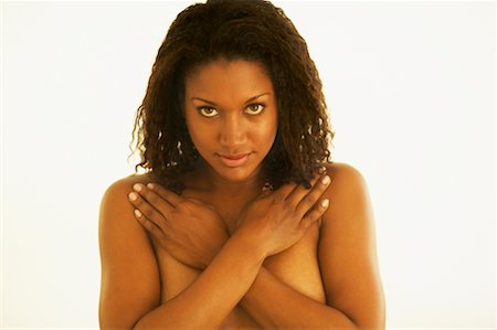 Portrait of Woman Covering Breasts Stock Photo - Rights-Managed, Code: 700-00550763